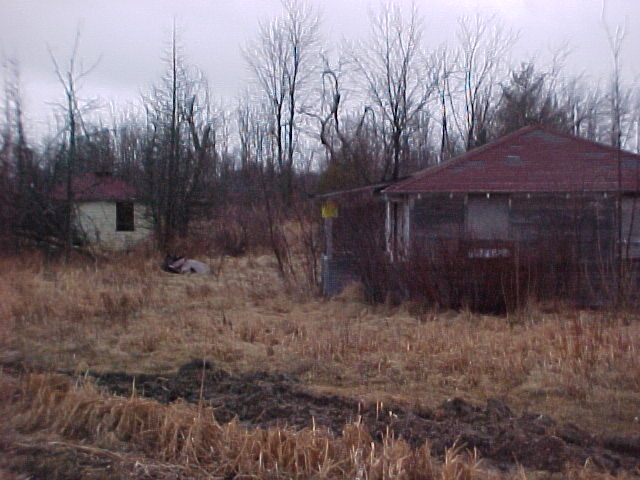 Remains of old tourist cabins and office on Route 26, just inside Alexandria Bay village limits.