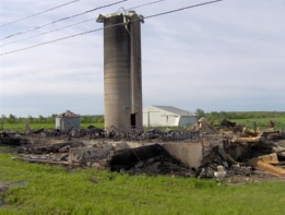The remains of the old barn, silo still standing